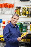 Worker Holding Tool Package In Hardware Shop Stock Images