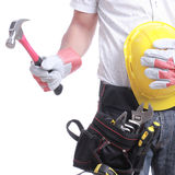 Worker holding tool Royalty Free Stock Images