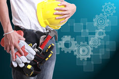 Worker holding tool for working Royalty Free Stock Images