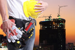 Worker holding tool for working Stock Photos