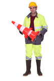 Worker holding a traffic cone Royalty Free Stock Photo