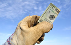Worker Holding a Twenty Dollar Bill Stock Photos