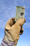 Worker Holding a Twenty Dollar Bill Royalty Free Stock Photography