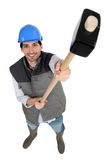 Worker holding up a mallet Stock Photo
