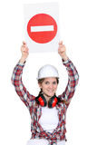 Worker holding warning sign Royalty Free Stock Image