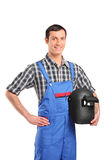 A worker holding a welding mask Royalty Free Stock Photography