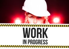 Worker holding work in progress sign on information board Royalty Free Stock Photography