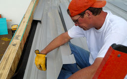 Worker holds aluminum sheets Stock Photos