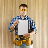 A worker holds clipboard Royalty Free Stock Photography