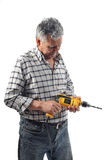 A worker holds an electric drill Stock Photos