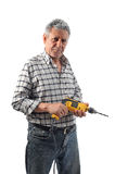 A worker holds an electric drill Royalty Free Stock Images