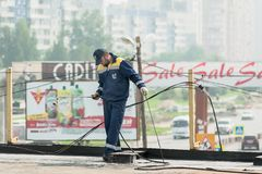 Worker holds a gas torch to waterproofing Stock Photo