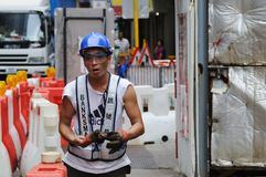 Worker in Hong Kong. Stock Photos