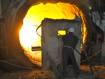 Worker with hot steel. Inside of plant Stock Photo
