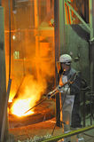 Worker with hot steel Royalty Free Stock Image