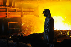 Worker with hot steel Stock Photos