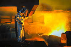 Worker with hot steel Royalty Free Stock Photos