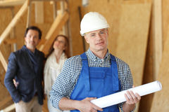 Worker and house design plans Stock Photo