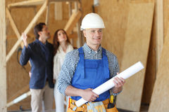 Worker with house design plans Royalty Free Stock Photos