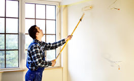 Worker house painter painted the walls in yellow Stock Images