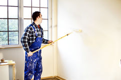 Worker house painter painted the walls in yellow Stock Photography