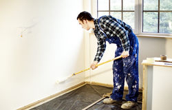 Worker house painter painted the walls in yellow Royalty Free Stock Images