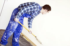 Worker house painter paints a wall Stock Images