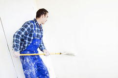 Worker house painter paints a wall Stock Image