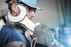 Worker with Huge Wrench. Worker with Huge Iron Wrench Spanner. Heavy Duty Maintenance Concept. Caucasian Technician in Blue Hard Hat Stock Photos