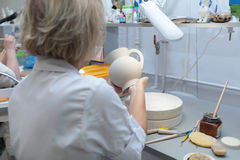 Worker in Imperial porcelain manufactory, St. Petersburg, Russia Royalty Free Stock Image