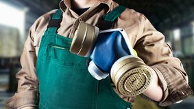 Free Worker In Green Overall Outfit With Respirator Stock Image - 150278981