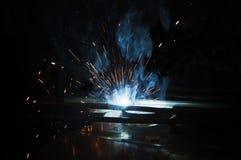 Process by manual welding. Splatter and smoke stock photo