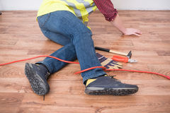 Worker injured after tripping. On  a cable Royalty Free Stock Photo