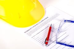 Worker injury claim hard hat with eyeglasses and Royalty Free Stock Photography