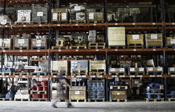 Worker inside store warehouse Royalty Free Stock Image