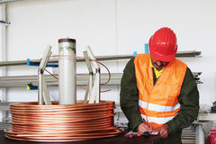 Worker inspect copper wire. Copy space available Royalty Free Stock Photos