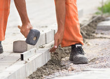 Worker instaling roadside blocks Royalty Free Stock Images