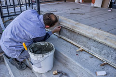 Worker Install Ceramic Stairs Tile 2. Worker Install Ceramic Stairs Tile at a building site royalty free stock images