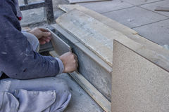 Worker Install Ceramic Stairs Tile royalty free stock images