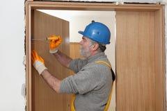 Worker install new door Royalty Free Stock Photos
