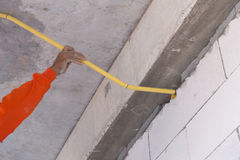 Worker install PVC pipes for electric conduit Stock Photos