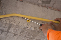 Worker install PVC pipes for electric conduit Stock Images