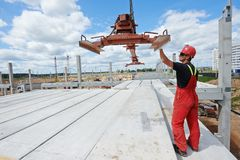 Worker installing concrete slab Stock Photos