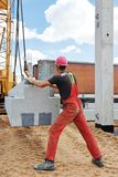 Worker installing concrete slab Royalty Free Stock Photos