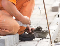 Worker installing curb stones Royalty Free Stock Photos