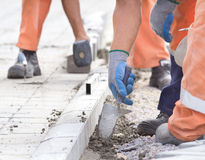 Worker installing curb stones Stock Photos