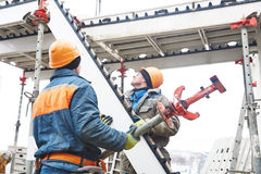 Worker installing falsework construction Stock Images