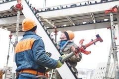 Worker installing falsework construction Stock Images