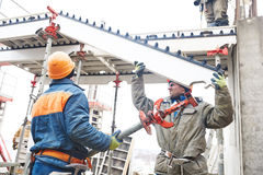 Worker installing falsework construction Royalty Free Stock Image