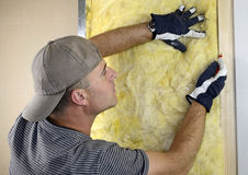Worker installing fiberglass insulation Royalty Free Stock Photography